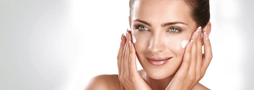 beautiful woman applying skincare